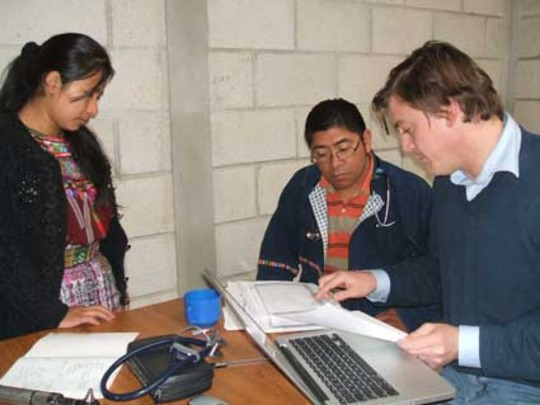 Herlinda, Cesar, and Peter discussing a case.