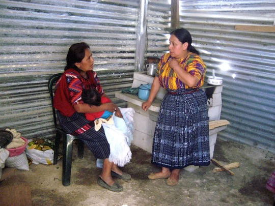 Yoli speaking with a mother in Chutinamit