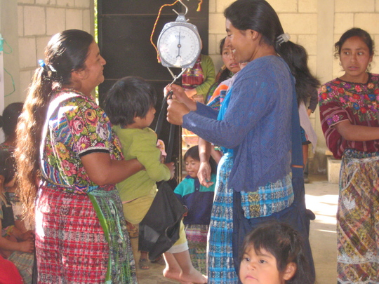Workers from Paquip and Paya' Weighing Children