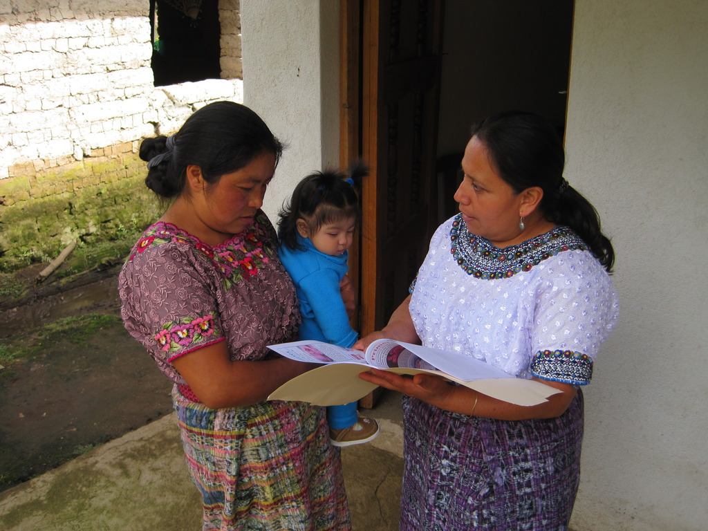 Yoli, our health educator talking with a mom