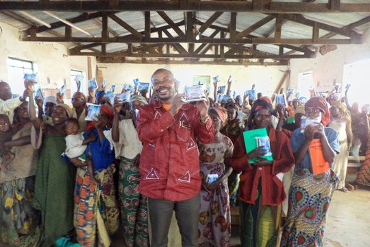 Traditional birth attendants holding up kits