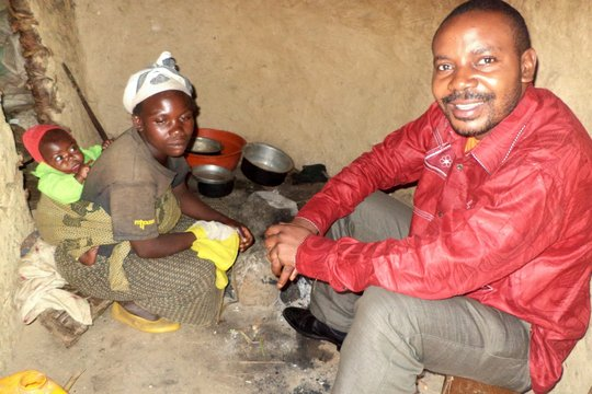 Dr Luc visiting a pigmie woman in her home