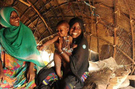 Mother and baby inside their home