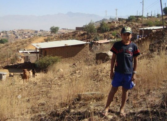 Child in a typical suburban area in Cochbamba