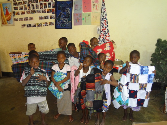 Children enjoying donated blankets