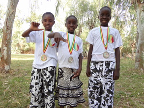 Children wearing their medals