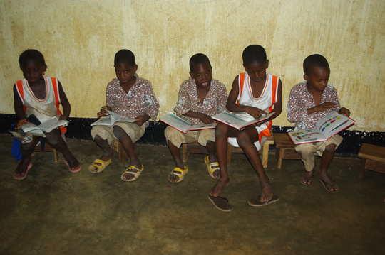 ACFA-Mali Boys reading