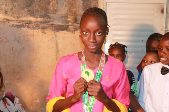 Diakassan with her medal