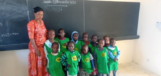 Students and teacher in class