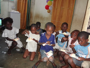 children eating at ACFA-Mali