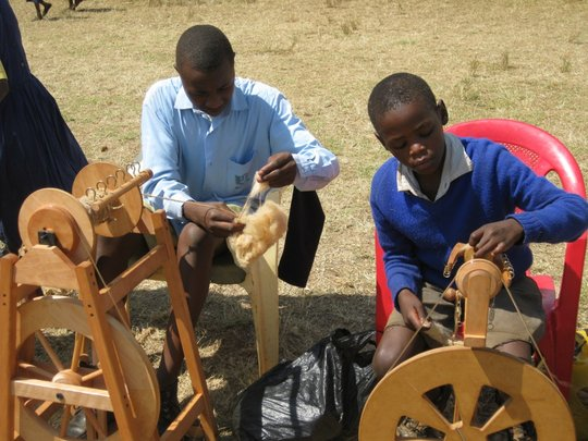 Mukinyai students demonstrate wool spinning