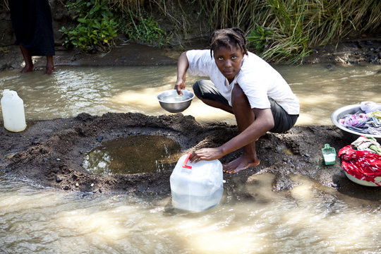 Collecting Drinking Water from the River