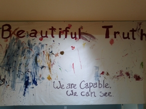 "A banner for the art exhibit ""A Beautiful Truth"""