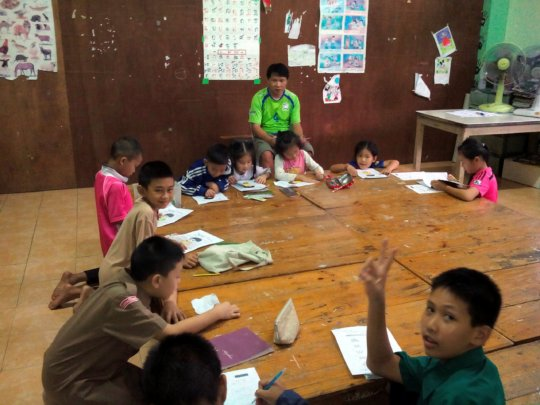 Teacher Somboon during an English beginners class