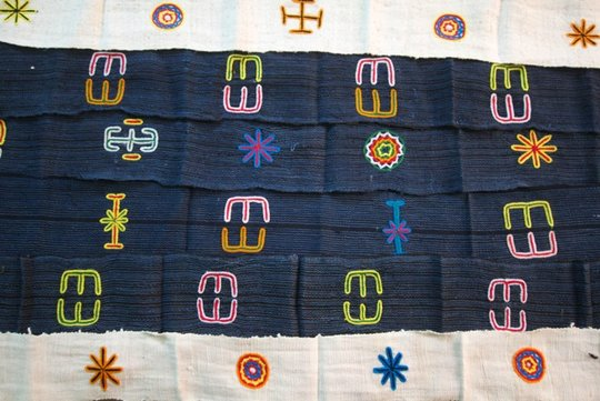 Cotton strips with embroidered symbols