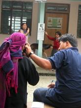 Dr. Tabin giving an eye exam. Photo by Chryl Martin.