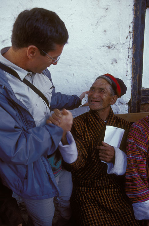 Dr. Tabin with a patient. Photo by Michael Amendolia.