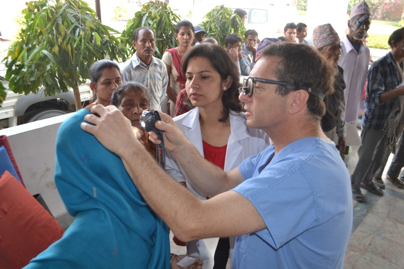 Dr. Sharma and Dr. Tabin examine patients