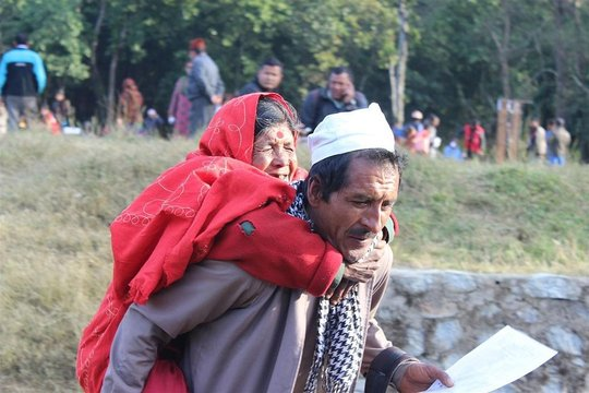 Patient carried to outreach in Nepal.