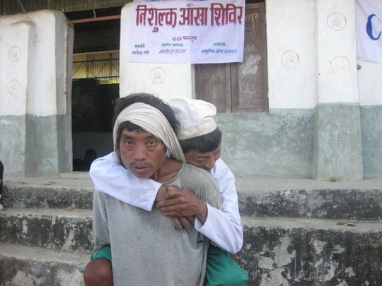 patient carried to a screening camp.