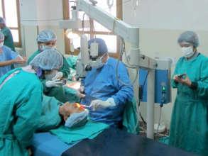 Dr. Sanduk Ruit Operating.