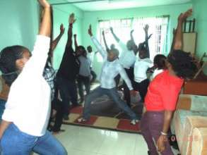 Scholars practicing yoga
