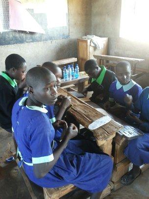 Girls learning to make sanitary pads
