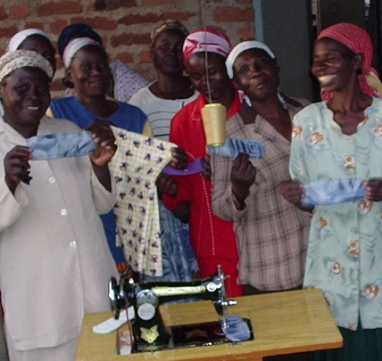 Women's group displaying reusable sanitary towels