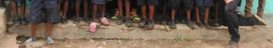 These kids have shoes that are wearing out