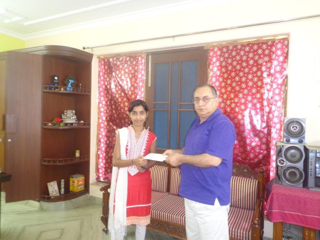 Neha receiving her scholarship for Higher Studies