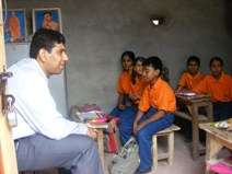 Volunteers from Dell with children