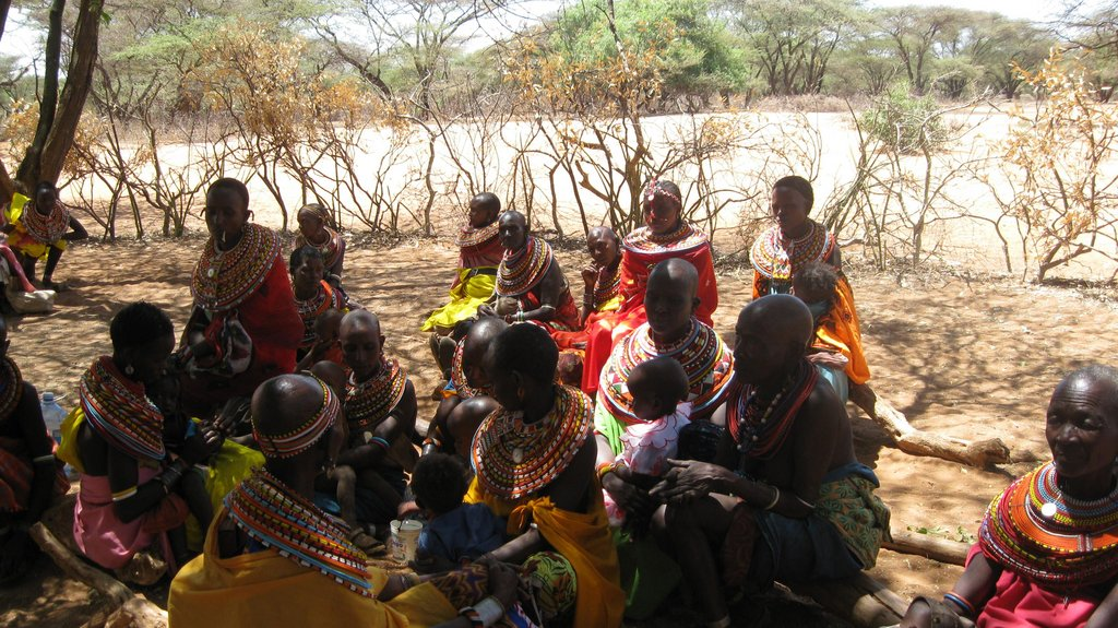 Women gathering for a community info mtg
