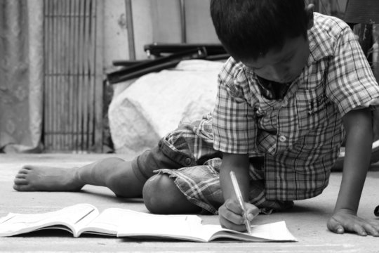 A student captures a child studying.