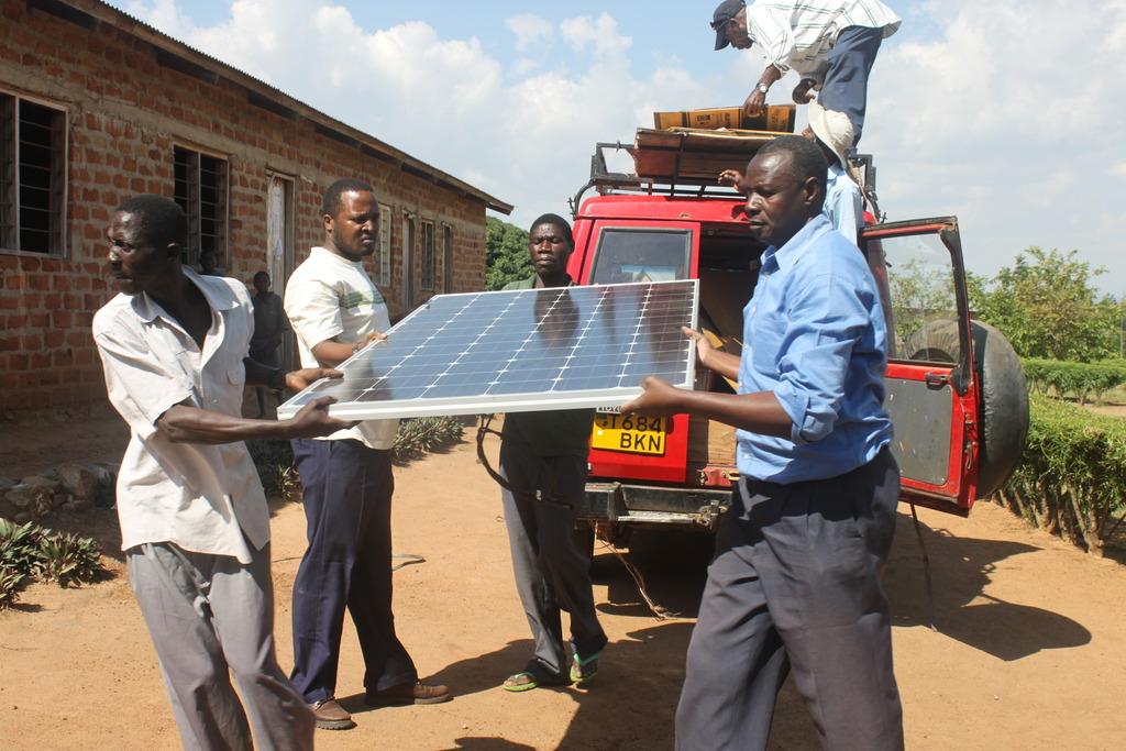 TanzSolar staff unloading solar panels