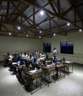Students studying by solar lights of classroom 1