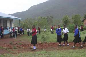 Girl students heading to classroom.