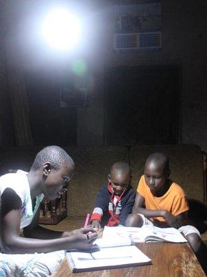 Students study by a solar light