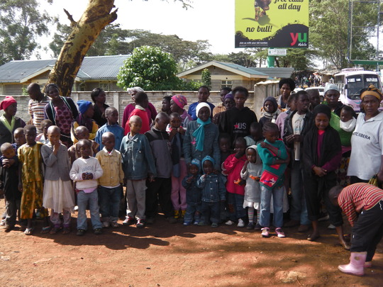 10 new mamas with their kids ready to leave Kibera