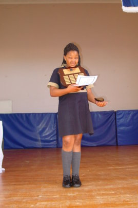 Nontando receiving an award in 7th grade