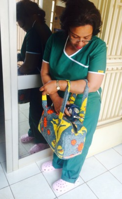 One of our surgeons with her HPV cloth bag