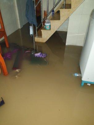 Flood waters from front door and under the floor