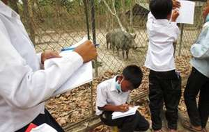 Taking notes as they meet each animal.