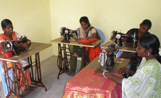 Young girls learning Tailoring