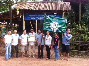 CBET Members with National Tourism Award and Flag