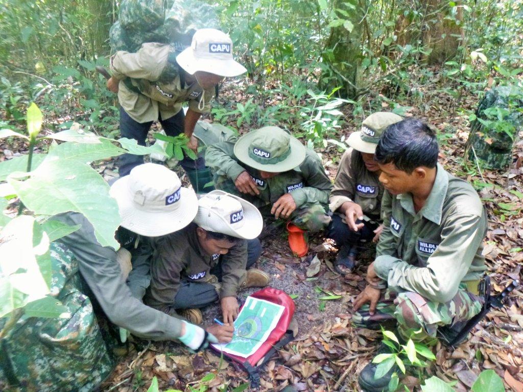 Community rangers identifying snare hot zones