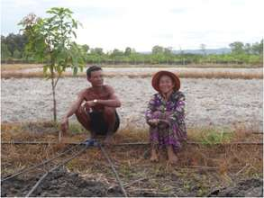 Nak Sok and his wife on their farm