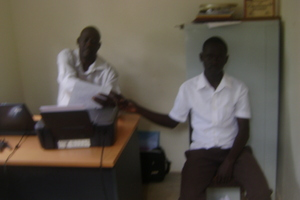 ISAAC IN KADO OFFICES SUBMITING HIS REPORT