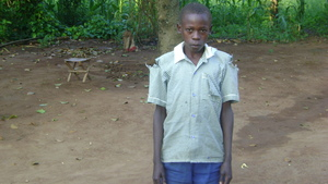 IBRAHIM AT HIS AUNT'S COT YARD, IN SCHOOL UNIFORM