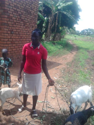 Graduated beneficiary with her goats