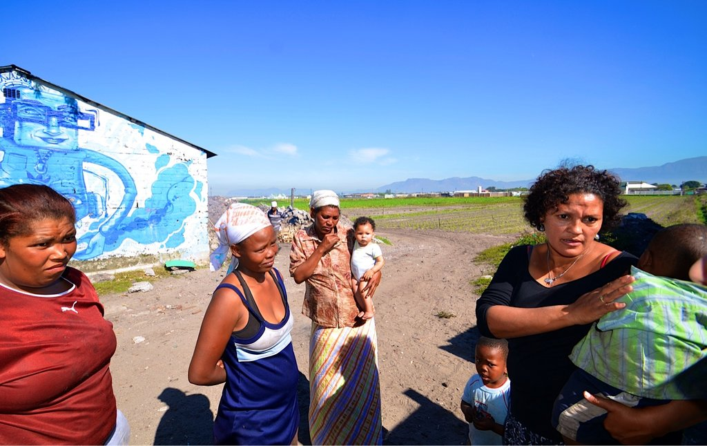 Tyron, his mother (in blue) and other farm workers